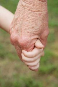 grandparent holding child's hand